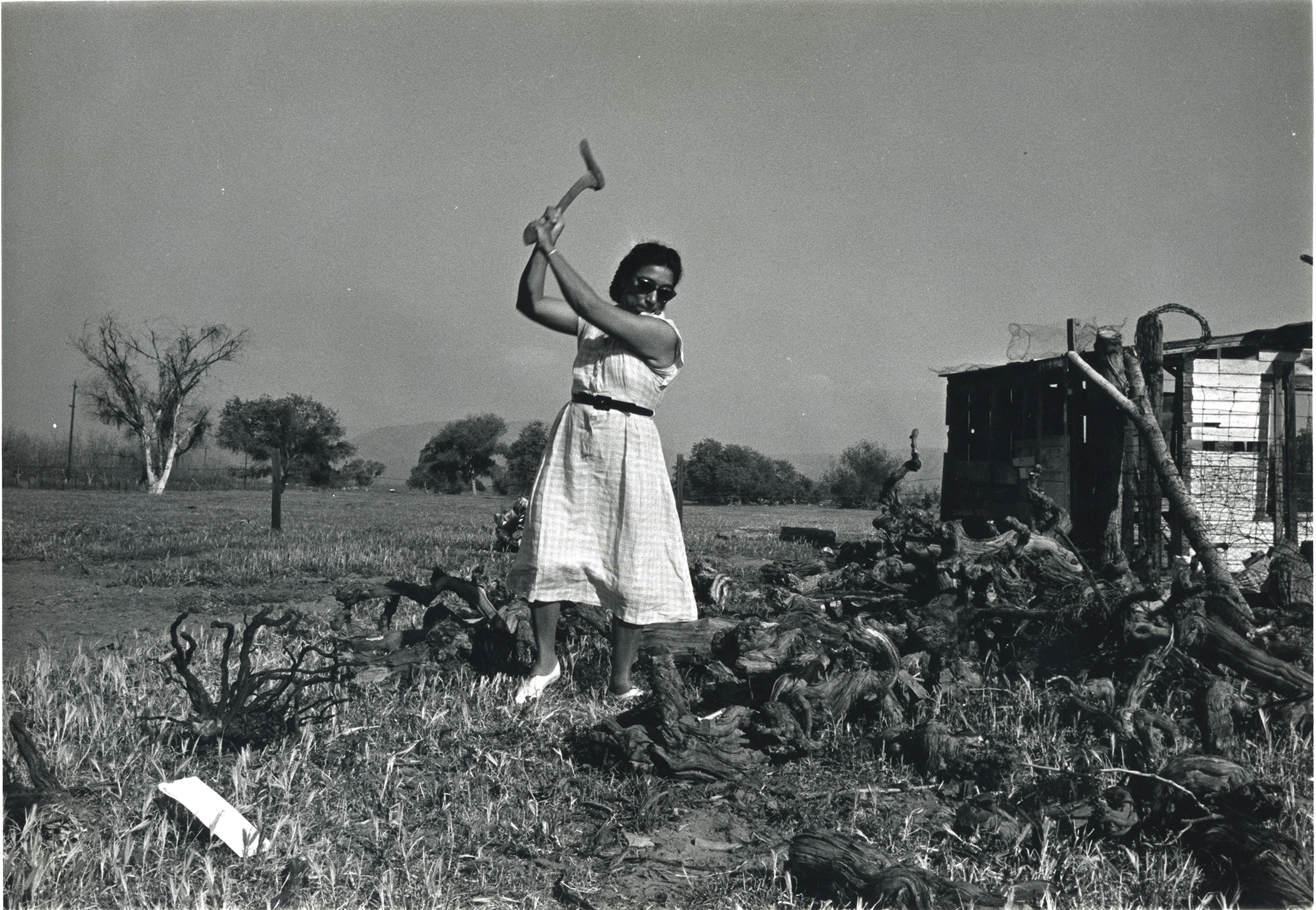 Maria chops wood in her home in rural California. Credit: © 1978 George Ballis/Take Stock