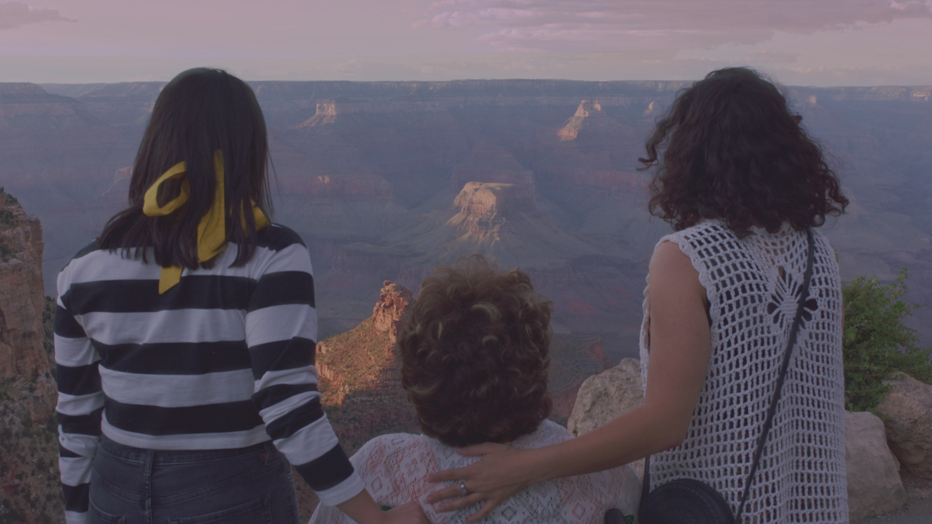 Marina, Juana, and Karina look out at the Grand Canyon.